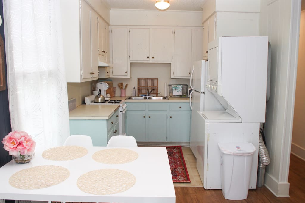 This is the view of our happy little kitchen as you walk in the front door -- check out those bright blue cabinets!