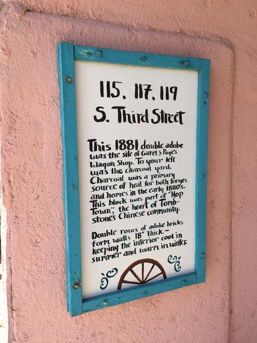 Historic description of Pink Adobe, roses under deck are cuttings from the world's largest, the Rosa Banksiae, over 130 years old