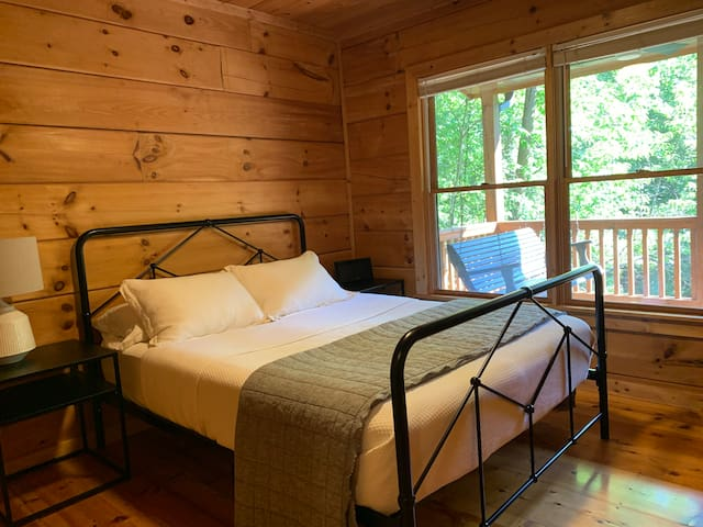 The master bedroom features a firm queen-sized bed