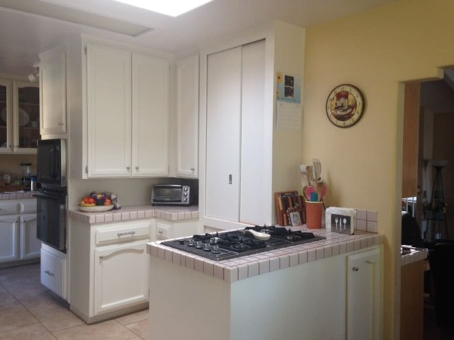 The eat in kitchen has seating for 6. We include a gas stovetop, oven, microwave, toaster, coffee maker and blender for your use.