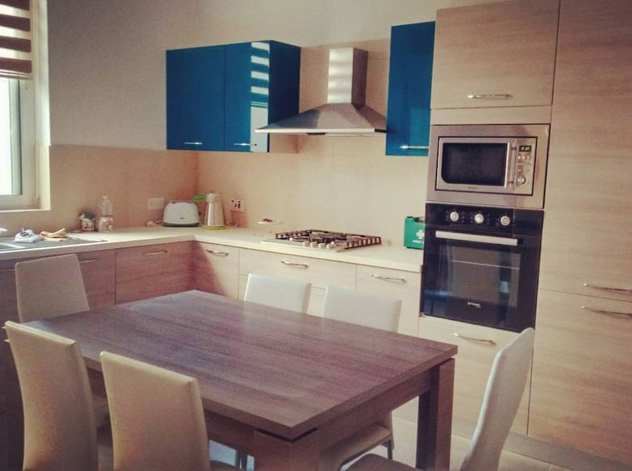 Kitchen. This is a shared space to be used by our guests at their own leisure. It is fully equipped with a hob, oven, microwave, kettle, toaster, kitchenware, utensils and more.