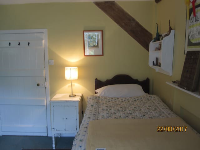 A high bed and sloping ceiling