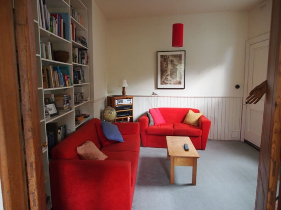 small sitting/TV room also has a sofa bed and lots of reading material