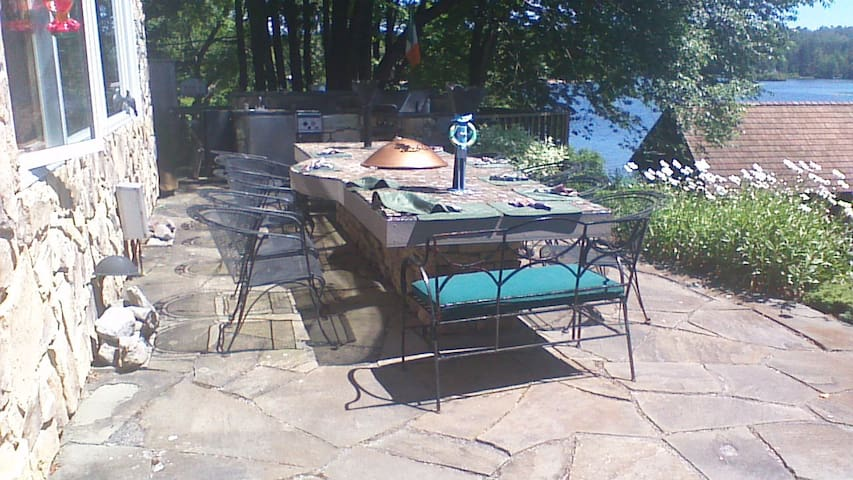 Out door table with  fire pit and gas torches.
