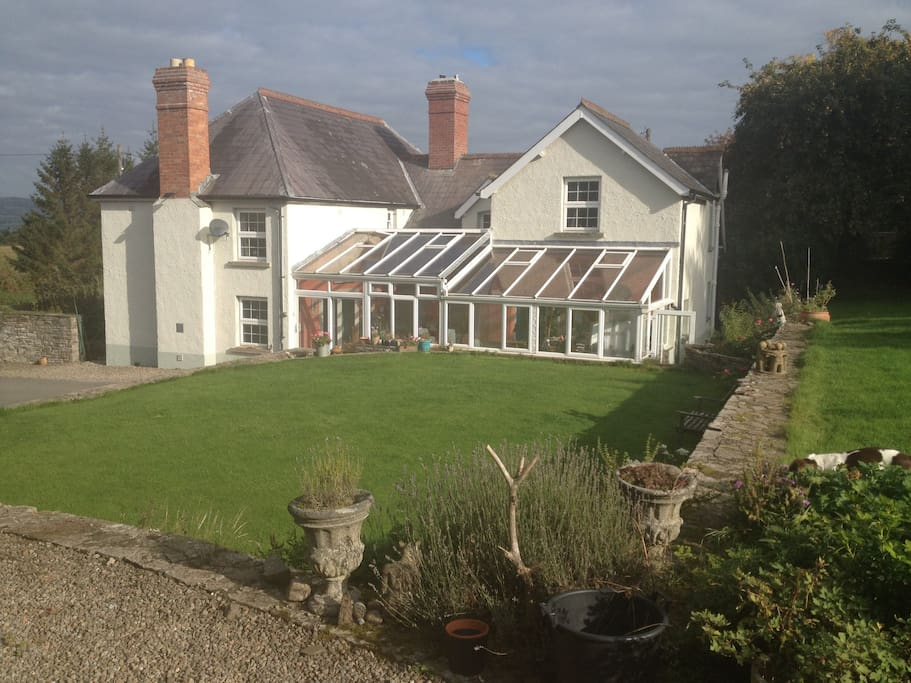Gwernyfed bandb exterior with ample parking.