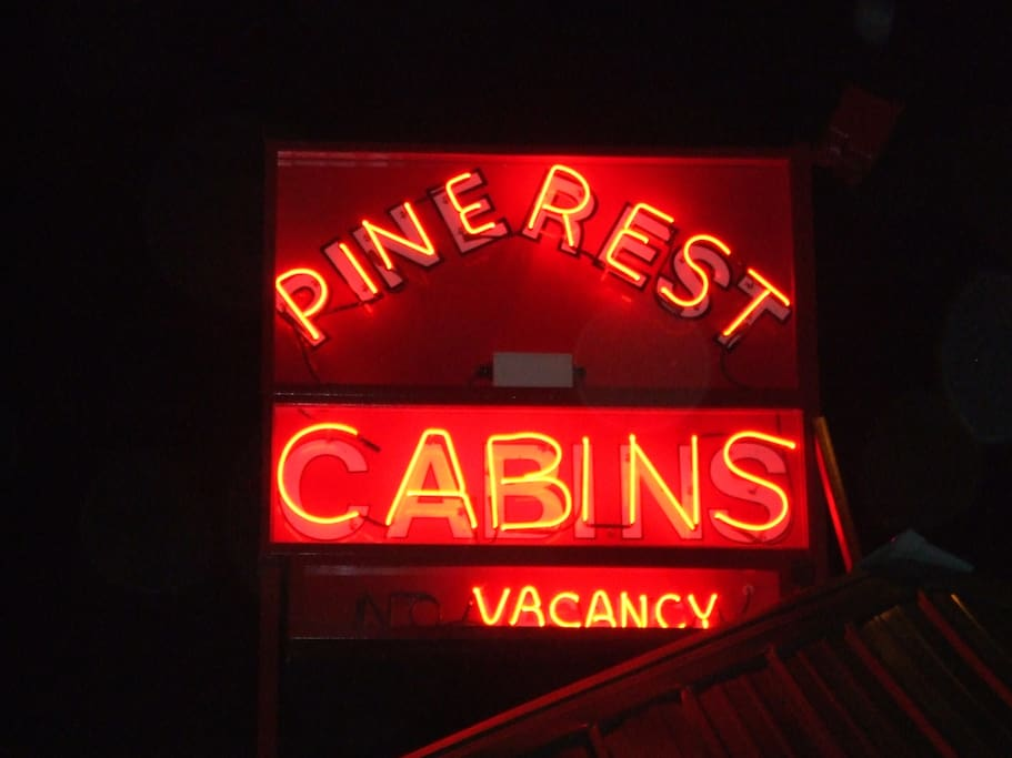Look for the vintage neon at PINE REST CABINS