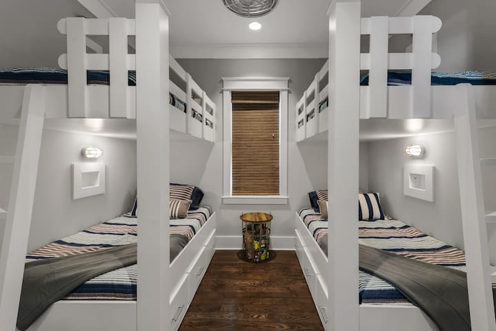 Bunk room with 4 twin beds, each has it's own lighting, own outlet