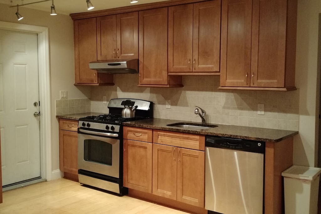 Gas oven and dishwasher in spacious kitchen