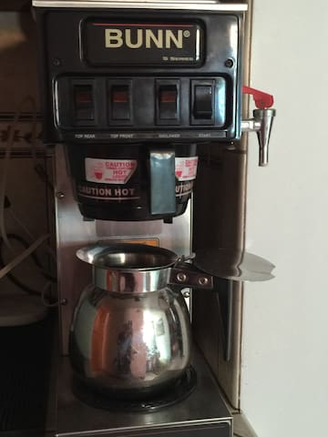 Left buttons: top burners; On/lower stays red when on; press Start only once for hot water.