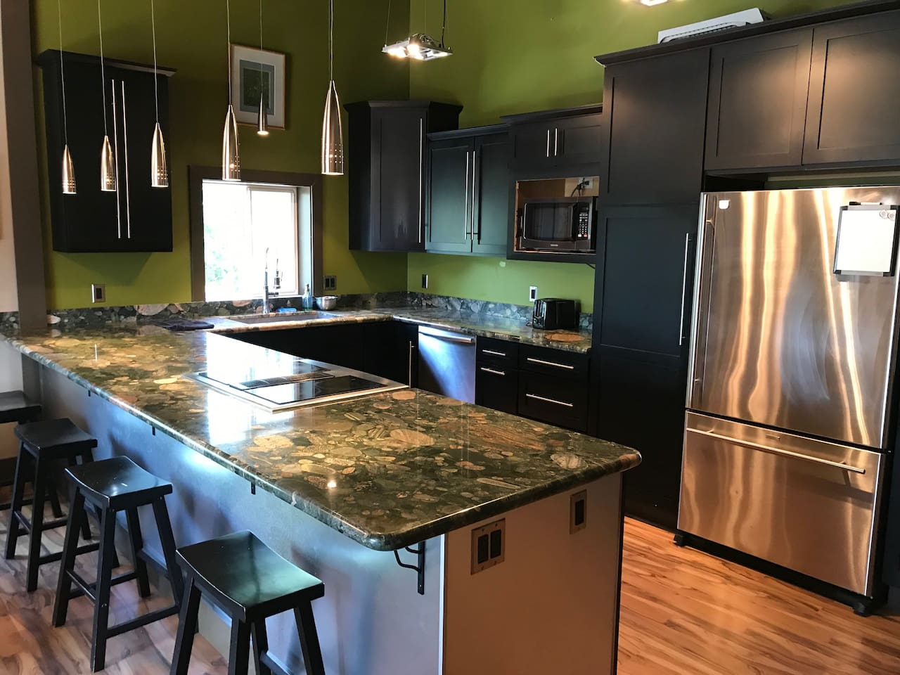Kitchen - large kitchen with beautiful stone counters, commercial appliances
