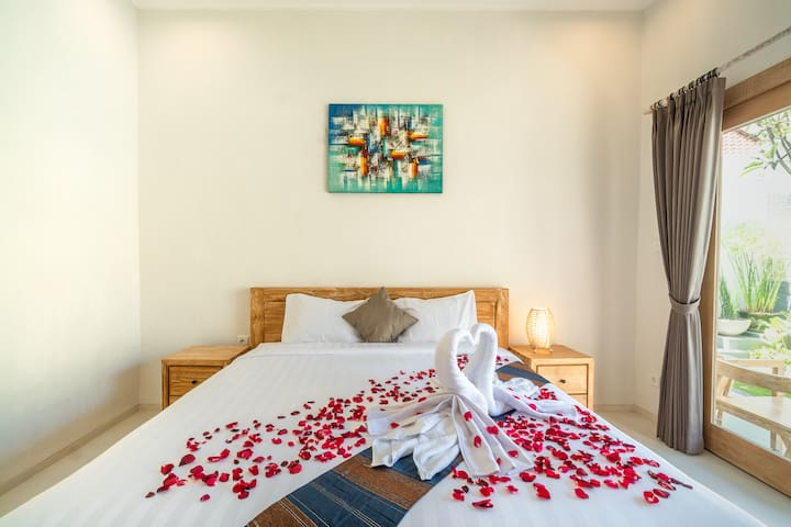 This is your bedroom, ensuite with a private semi-outdoor bathroom. We also provide a work desk & fast wifi, so you can do remote working from your room.