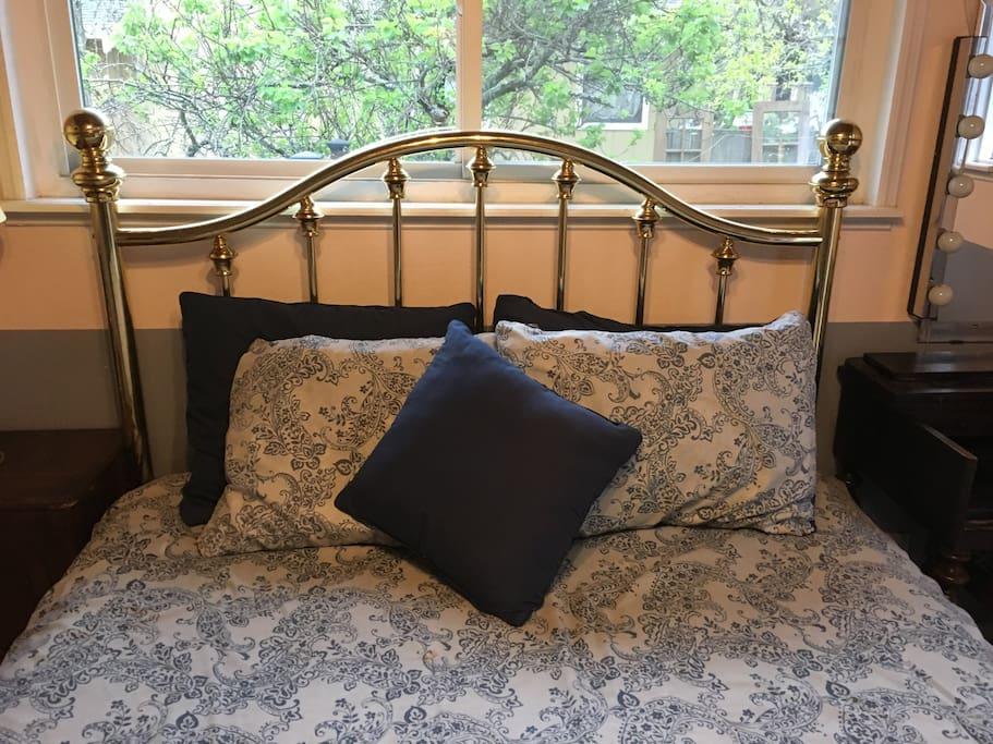 Queen firm bed in Bedroom one.