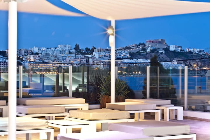 Ryans Ibiza - Urban beach club, chill out terrace with sunbeds and views.