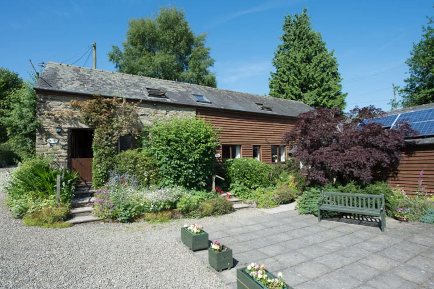 Mocktree Barns Holiday Cottages - South facing courtyard with views over the surrounding countryside.