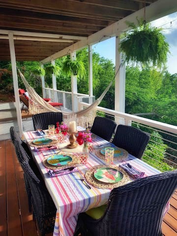 Bon appétit! Dining area on back deck; hammock and chaise lounge chairs in the background looking across the Caribbean to St. Thomas