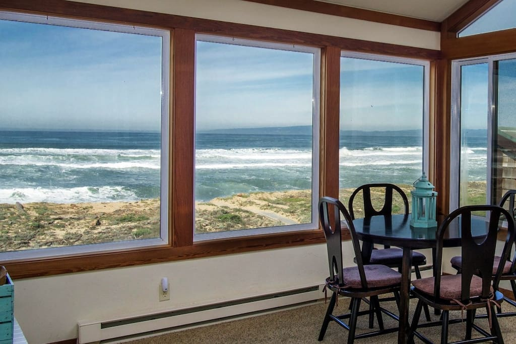 Table in upper level living room with brilliant ocean views