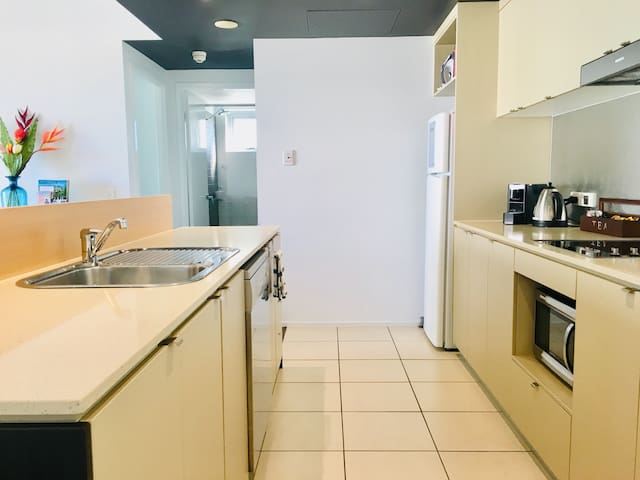 You'll be able to cook up a storm in this spacious kitchen with convection microwave, stovetop, full size fridge and dishwasher.