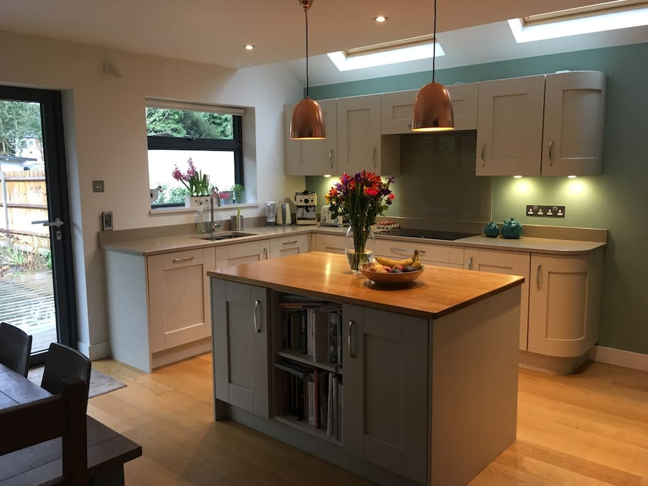The kitchen and dining area. American fridge freezer with ice dispenser and filtered water, double oven and microwave, induction hob, dishwasher, Dualit coffee maker. Dining table seats 6-12