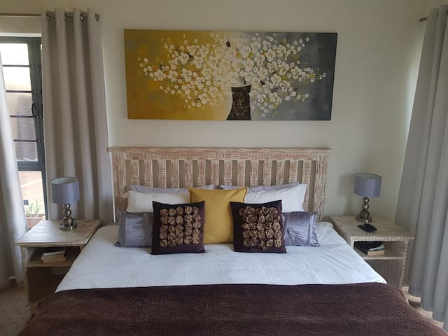Enjoy a good night's rest in this lovely room with small fridge, microwave, kettle & hairdryer.  Access onto stoep which leeds to garden by remote controlled vehicle access gate.  1 or 2 single beds, depends on booking requirement.
