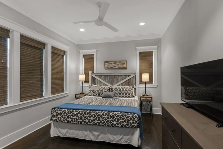 King bedroom, 2nd floor .  Custom blinds throughout, large flat screen TV, access to hall bathroom