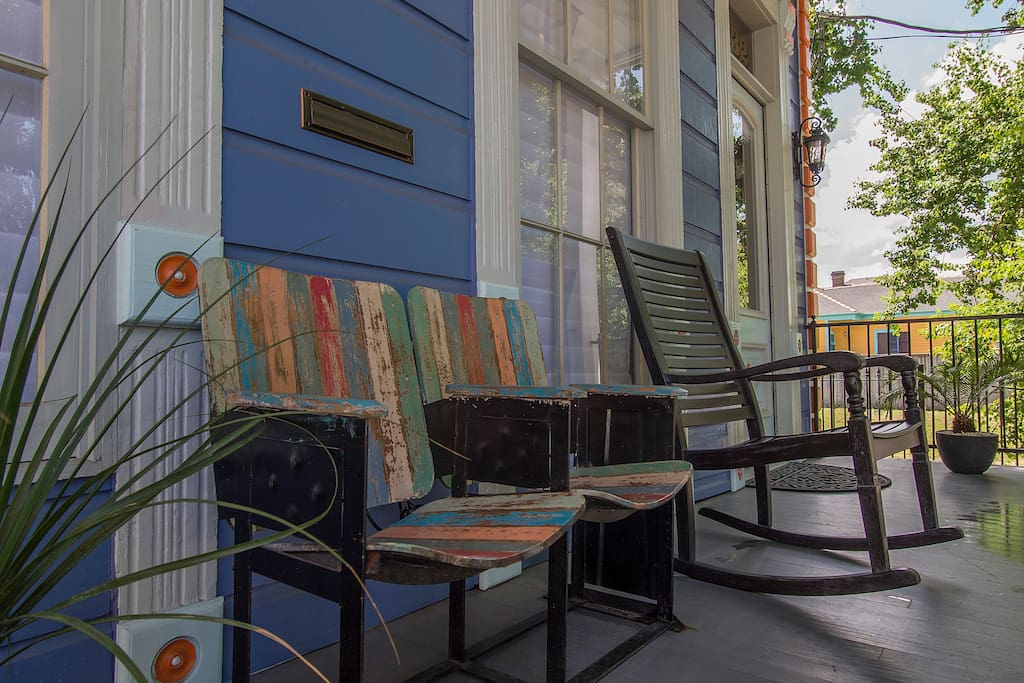 Guests are able to sit on the front porch and watch the neighborhood activities.