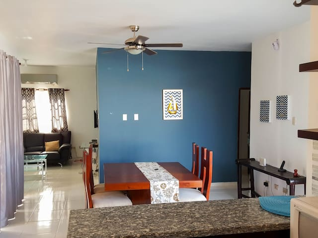 Open floor plan kitchen / dinning / living with air conditioning.
