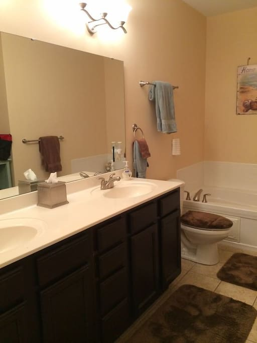 Master Bath with double sinks, soaking tub, and separate shower