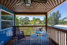 Front deck, with its western exposure, has dining for 4, a reclining chaise lounge and two club chairs.  It is fully screened and is a wonderful place to enjoy the spectacular sunsets.
