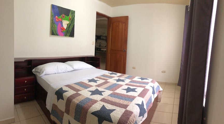 Second bedroom with comfortable full bed, orthopedic mattress, closet and fan.