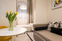 YELLOW: Suite deluxe - second room, one bed and one sofa set up