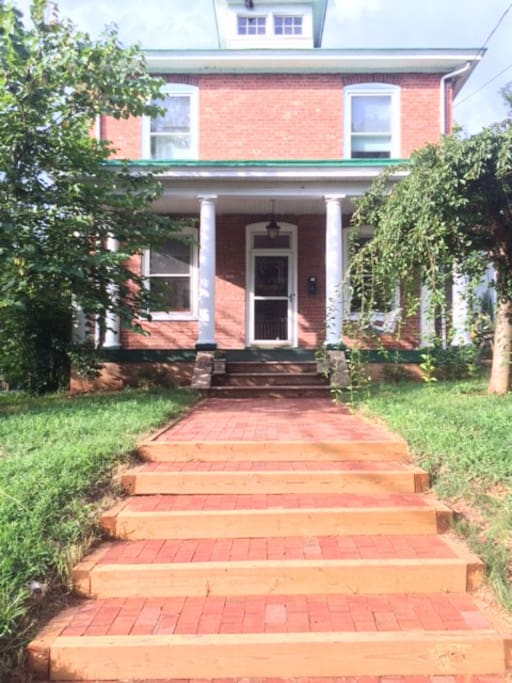 Beautiful Belmont Avenue entrance with porch and swing