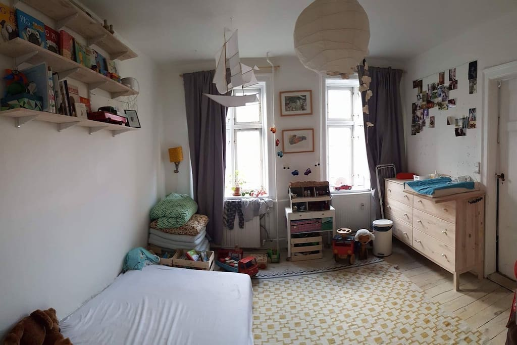 Kids room: queen size (120cm) box mattress, changing table and lots of toys + books
