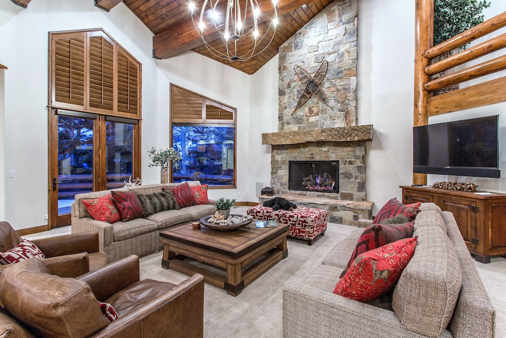 Great Room with vaulted ceiling and stone fireplace