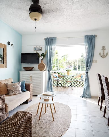 Bright and airy open plan living/ dining area in soothing blues and beachy colors.