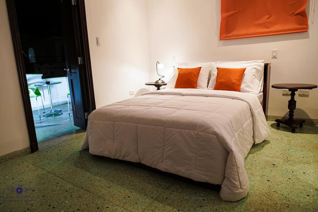 Room 1: privacy, double bed, air conditioner