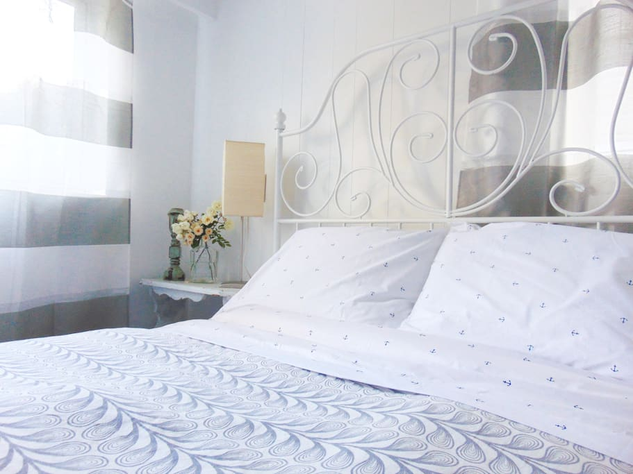 White wrought iron frame, double bed, new mattress.