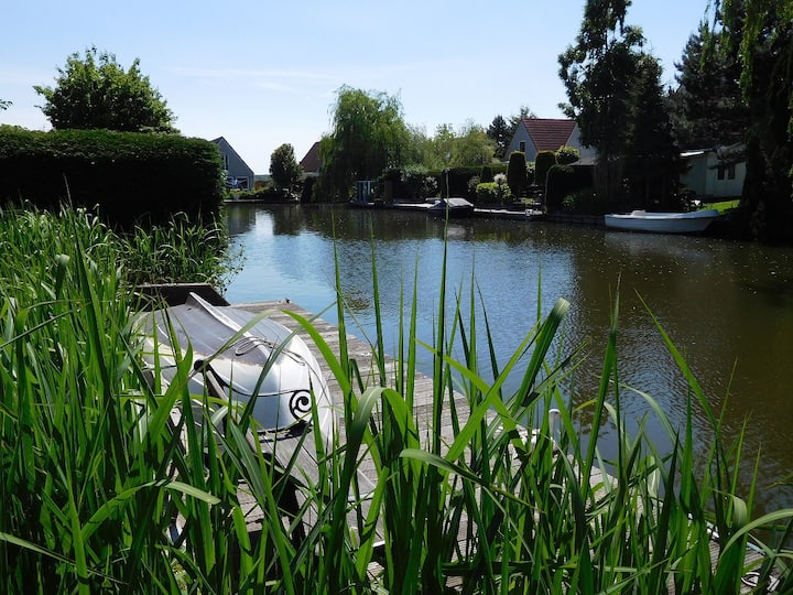 Bungalow at waterside with garden +  landing stage