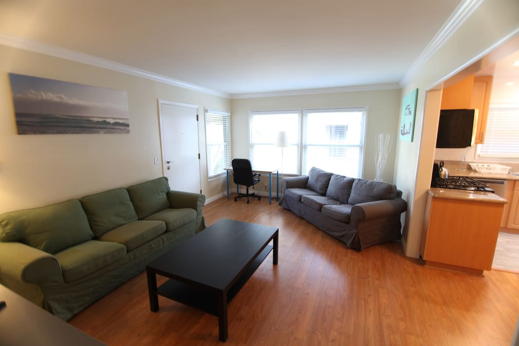Two Couches in Living Room and Desk/Office Chair Workspace