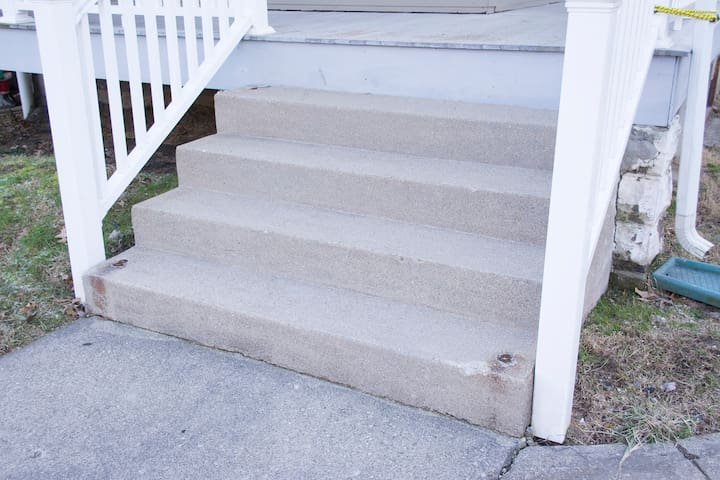Stairs leading to the porch entrance