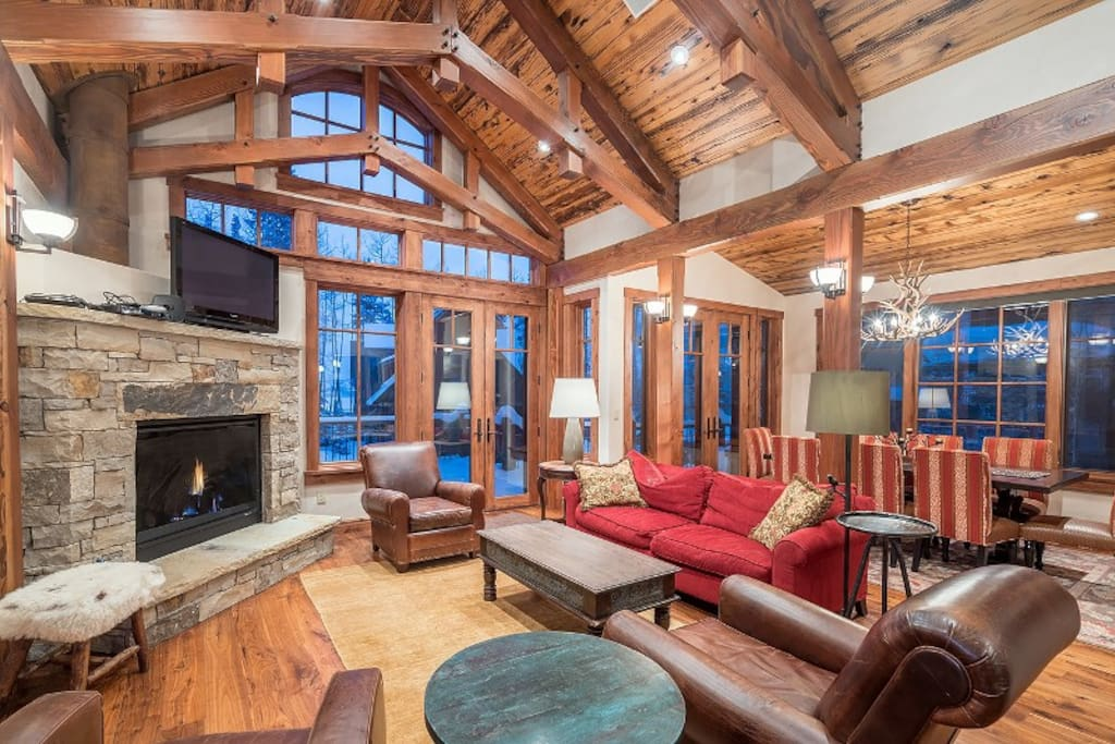 Vaulted ceilings and tall picture windows provide a grand yet cozy living area