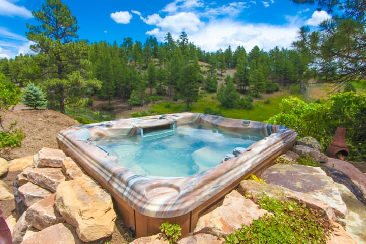 The hot springs is a short walk away, or you can take 10 steps from the back tub to the onsite hot tub!
