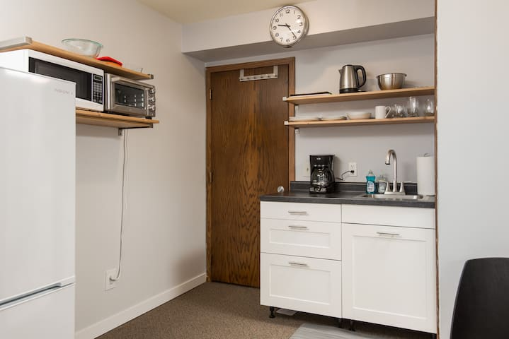 Kitchenette with 10 cubic feet fridge.  ** Go through the door to the left of the kitchenette to access the private bedroom with the 2nd Queen bed**