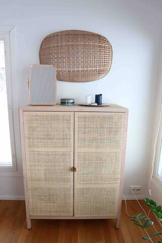 A lovely rattan cabinet for clothes.