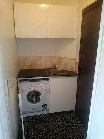 Coin cuisine avec machine à laver photo 1