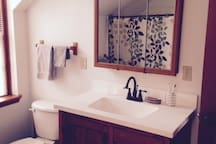 Large bathroom with shower, tub, washer and dryer.