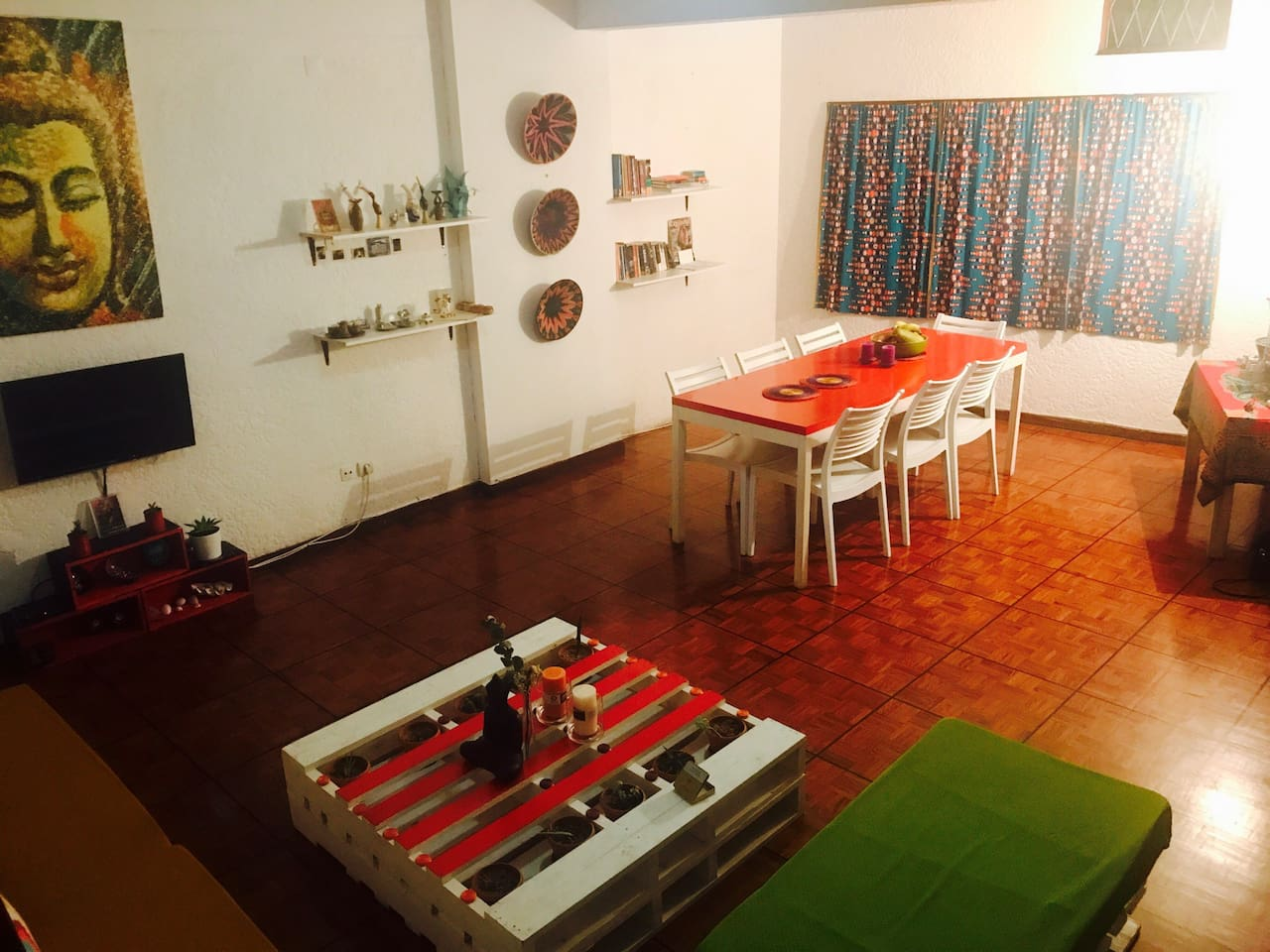 Living/Dining room on the 1st floor with combination of Oriental and African decor