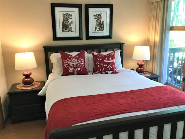 Bright bedroom has queen size  bed and blackout curtains