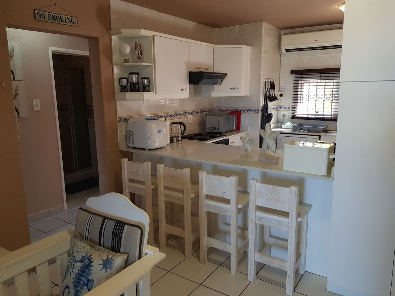 The kitchen is well equipped with a large fridge, oven & extractor fan, dishwasher, microwave, ice machine, etc.