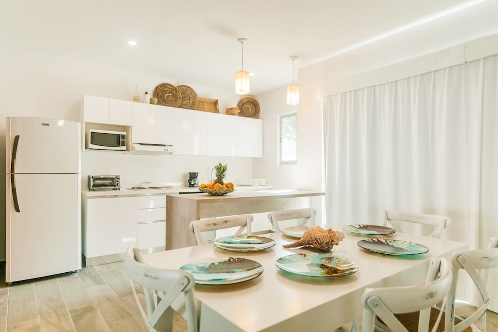 Dining area and a fully equipped kitchen