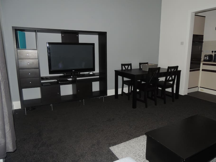 Dining area next to small kitchen